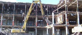 demolition crane tears down building