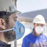 Demolition workers wearing pandemic-related PPE